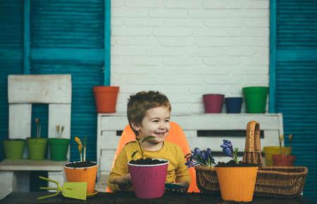 Happy child with plants. Vegan or vegeterian concept.