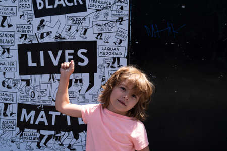 Miami, FL, USA - JULY, 2020: Happy child and Black lives matter poster.