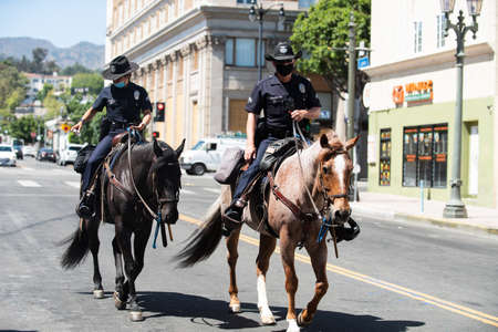 Los Angeles, California, USA - 2020 Horse Police in LA. Riding on the streets.