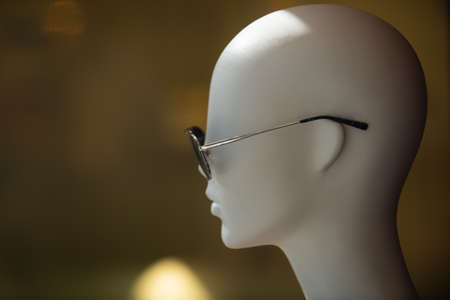 Bald mannequin with sunglasses. Fashion and retail.