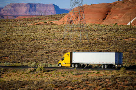 Arizona, USA - 2020: American trucks in mountains. Roads in the United States, delivery of goods. Transport business.