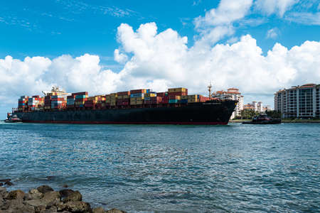 Miami Beach, Florida, USA - 2020: Cargo Ship. Container, import export commerce business trade logistic and transportation. Sealand Michigan.