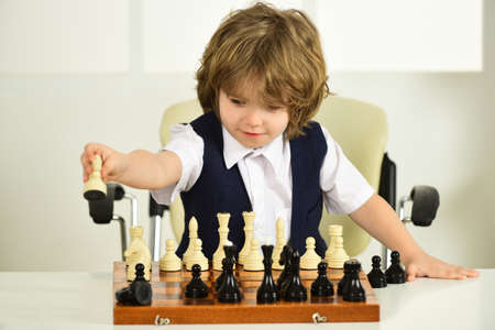 Chess for kids. Strategy and difficult decisions. Chessboard. Boy child plays chess. Mind, intelligence, intellect, child brain.