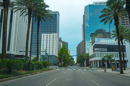 New Orleans, Louisiana, USA - JUNE, 2020: Streets in New Orleans. Road and skyscrapers in downtown.