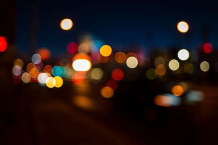 Bokeh background. Big city lights, travel and roads. Vintage defocused night colors. Abstract blur evening. 免版税图像