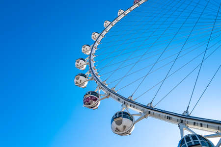 Las Vegas, Nevada, USA, - 2020: High roller ferris wheel in Las Vegas. Sky view cityscape in a world famous Vegas Strip in US. Best travel, hotels, attractions, tours, show and clubs. 免版税图像