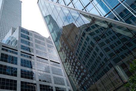 Glass and metal, jungle stones. Skyscrapers. Downtown in big US cities. Windows of offices of large companies, finance.
