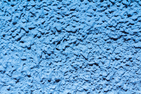 Beautiful blue background of rocks. Surface looks like drops and bubbles.
