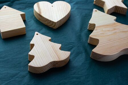 Detail for woodwork. Joinery. New Year wooden products. Workshop, development of wood products. Wooden heart, firtree, house. Manufacture of wooden doors, windows, furniture. Merry Christmas eco toys. 版權商用圖片