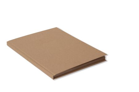 Sketchbook with a hard cardboard cover on white background. Close-up. Mock up stock photo, side view. Selective focus, portret format. Brown Kraft Sketchbook, Journal, Diary, Note Book. Stock Photo