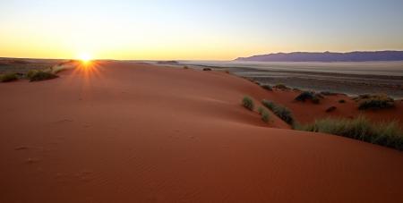 Sunrise over the dune Stock Photo