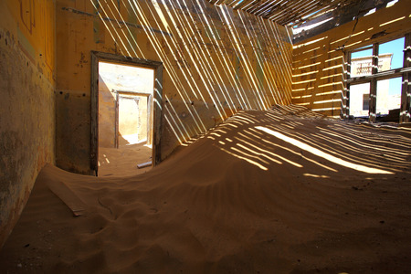 Sand filled room at Kolmanskop photo
