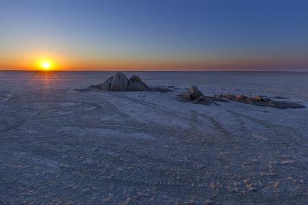 sua: Rocks on Sua Pan at sunset