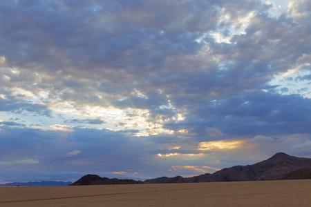 Sun rays through clouds 스톡 콘텐츠