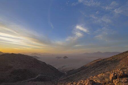 Sunset during dust storm in the Namib Desert Stock Photo