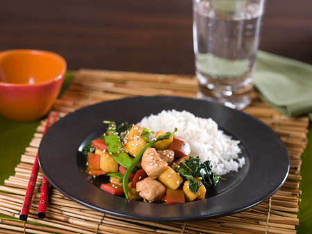 Chinese Chicken Teriyaki and Vegetable stir fry with chopsticks Stock Photo - 54006755