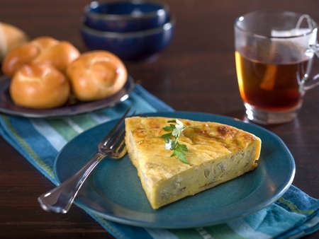 Slice of cheese and onion quiche