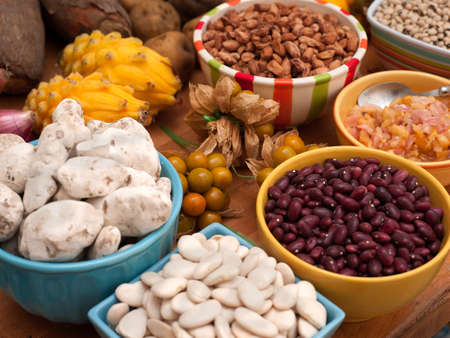 Assortment of Peruvian beans and legumes in bowls on wooden table top