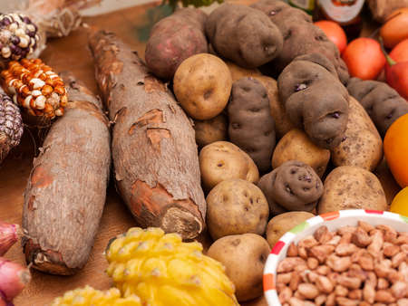Assortment of Peruvian potatoes, yucca, corn, and beans