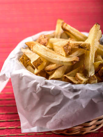 Basket of french fries on red place mat