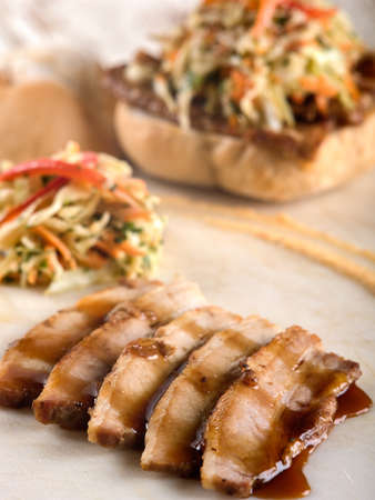 Sliced pork with Teriyaki sauce on white cutting board Stock Photo - 56402949