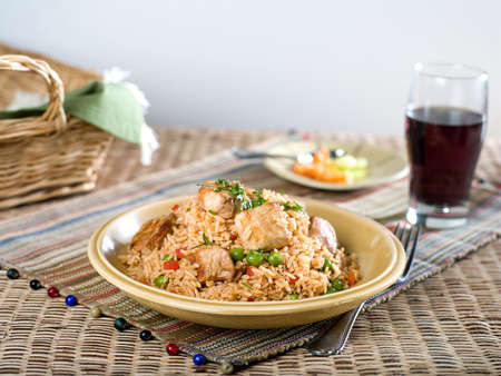 Pork with vegetable fried rice on textural place mat