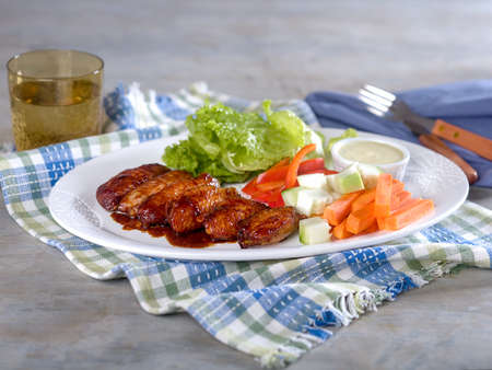 Chicken wings and vegetables with ranch dip served on white platter Stock Photo - 56403093