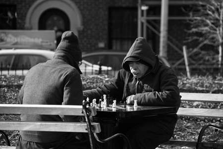 chess men: Men playing chess in NYC Editorial
