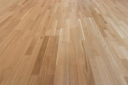 オーク材の床の寄せ木張りラミネート - 背景テクスチャ 写真素材