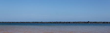 nger: Water and rocks - Ocean horizon, blue sky, background