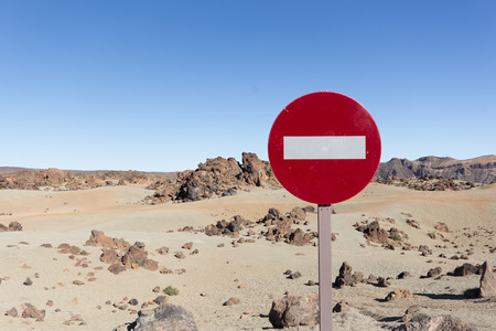 nger: volcano landscape  desert - sand, rocks, blue sky - traffic sign - no trespass Stock Photo