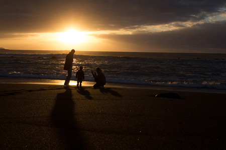 ensuring: Parents and child - family silhouette sunset -Beach