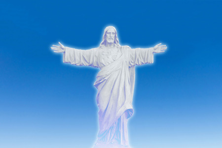 Jesus Christ statue isolated on white blue sky heaven