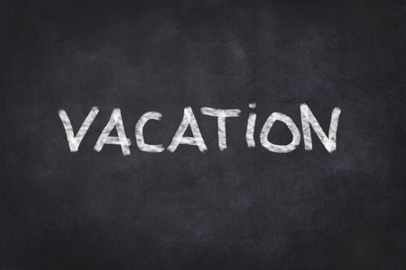 hollidays: Vacation text on chalkboard Stock Photo