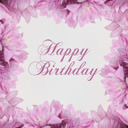 白い背景の上の幸せの誕生日花 写真素材