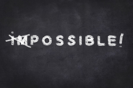 possible impossible motivation text on chalkboard