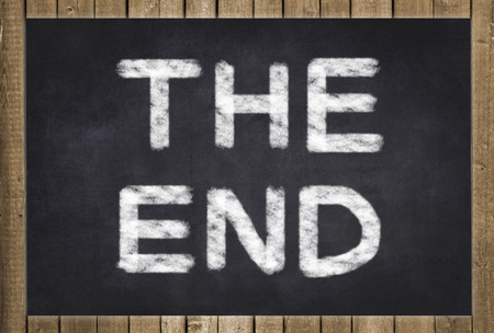 terminated: The End written on chalkboard Stock Photo
