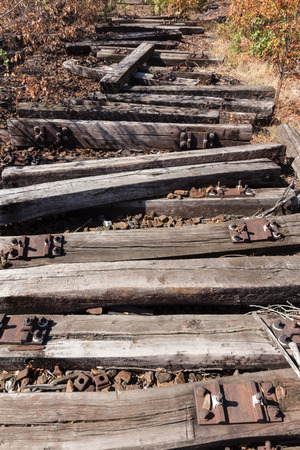 wood abandoned: old railway, railroad, railtrack, abandoned, destroyed and overgrown wood Stock Photo