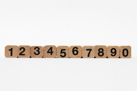 numers: Numbers one to ten on wood cubes isolated on white background