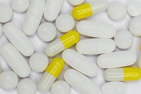 white pills: Many white pills capsules medicine macro