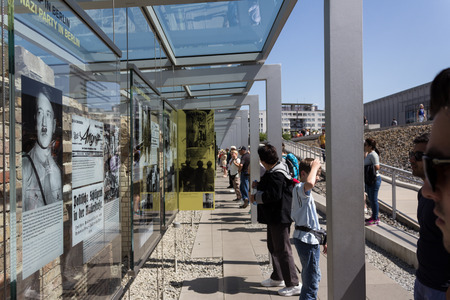 iron curtains: Tourists at outdoor museum, berlin wall second world war exhibition