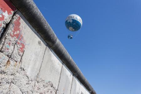 iron curtains: berlin wall, hot air balloon Editorial
