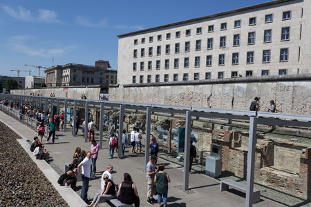 iron curtains: berlin wall, tourists at outdoor museum