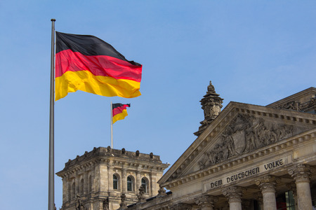german flag: German flag on Reichstag building in Berlin: German parliament Stock Photo