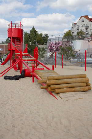 sandpit: kids playground with red slide, climber and sandpit Stock Photo