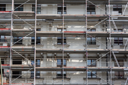 apartment shortage: building construction site with scaffolding