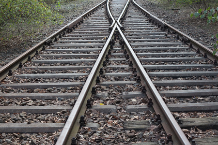 split rail: splitting Railroad, double-track railroad, rail tracks Stock Photo