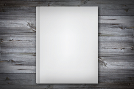 wooden desk: white book cover - empty white book cover on a wooden desk Stock Photo