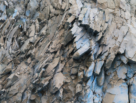 rock texture: grey mountain rock panorama background - abstract stone formation, folded rocks