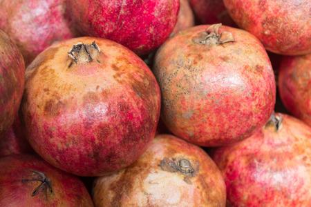 multiples: many pomegranates background - grenadine fruit background